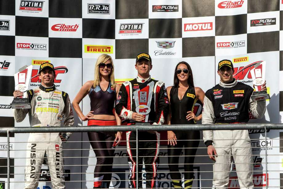 Podium finishers, left to right, Bryan Heitkotter, Patrick Long and Michael Cooper celebrate after the Pirelli World Challenge GT race at Circuit of The Americas on March 5, 2016 in Austin, Texas. Photo: Brian Cleary, Getty Images / 2016 Brian Cleary
