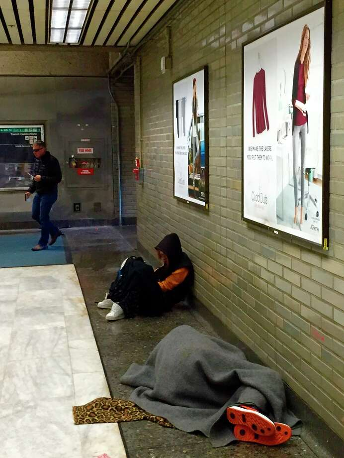 Homeless people in the Civic Center BART station in San Francisco Photo: Andrew Ross /