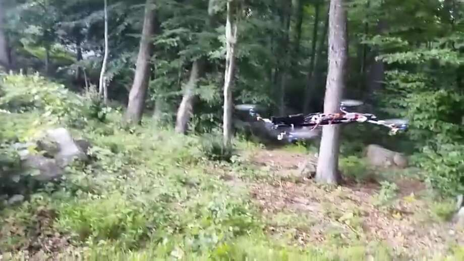 A homemade drone armed with a handgun is shown flying and firing off several rounds of ammunition in this YouTube video posted in July 2015 by Austin Haughwout, who was arrested and expelled from Central Connecticut State University after the incident. Photo: YouTube