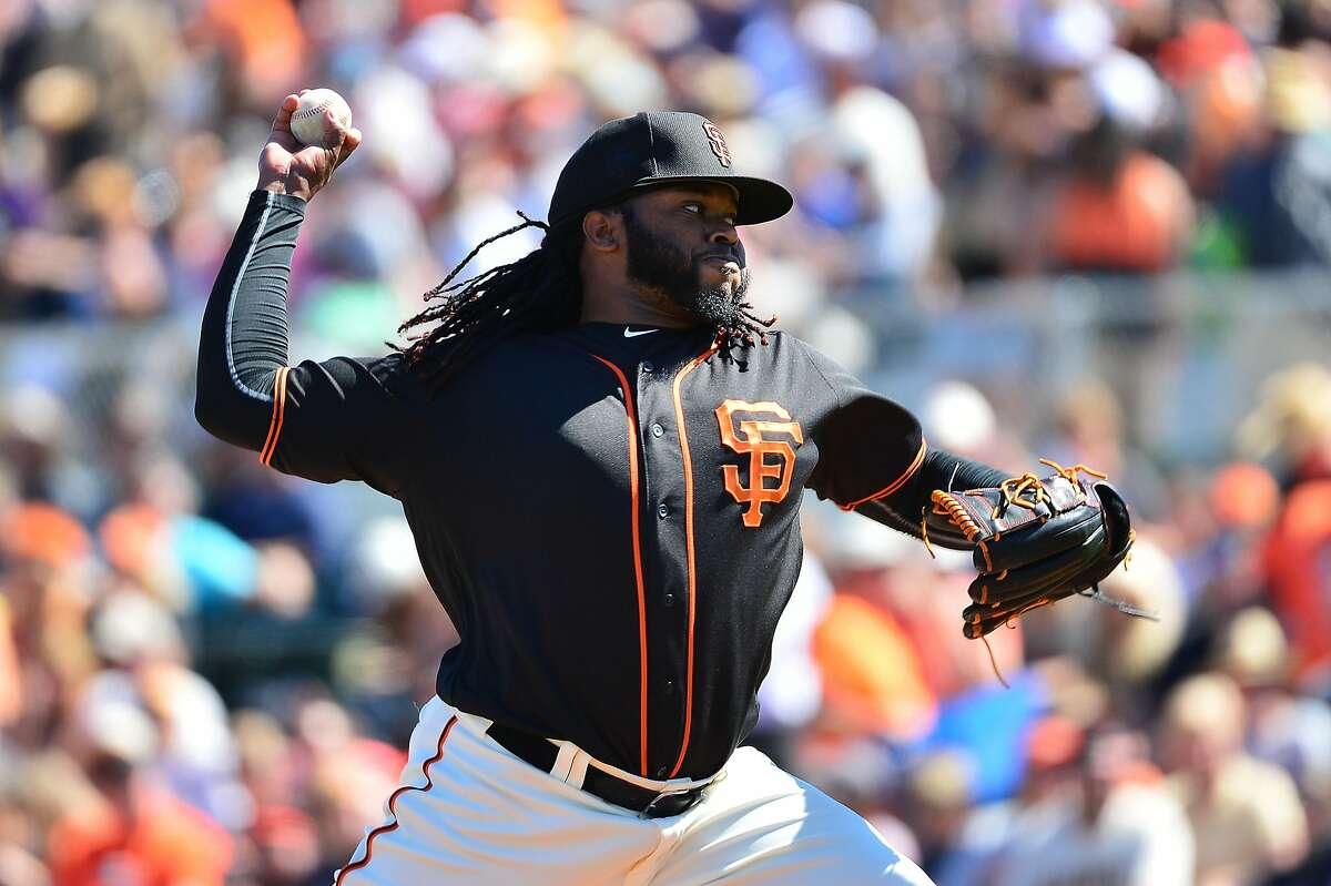 Starting pitcher Johnny Cueto #47 of the San Francisco Giants delivers a pitch in the first inning against the Colorado Rockies during the spring training game at Scottsdale Stadium on March 9, 2016 in Scottsdale, Arizona.