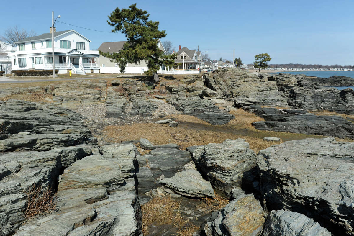 108 Beach Ave., seen here to the upper left, stands across the street from Merwin Point in the Woodmont section of Milford, Conn. March 1, 2016. Merwin Point, thought for generatons to belong to the City of Milford, actually belongs to the owner of 108 Beach Ave. A 3-foot high fence with one no trespassing sign was approved by the Zoning Board of Appeals