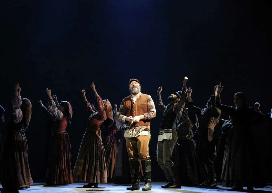 "Danny Burstein, center, as Tevye, and cast rehearse ""Fiddler on the Roof"" in New York. The cast recorded an album of the Broadway revival on the Broadway Records label. The album will be available on March 18. Thirty-two cast members and 22 orchestra players squeezed into a New York studio to record the album.  Photo: Joan Marcus, HONS / Joan Marcus via Jeffery Richards Associates"