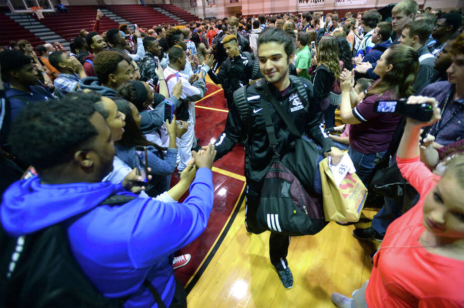 Surrounded by fans, Kolten Mackey leads the Silsbee basketball team through a pep rally at the school's gym Wednesday morning. The team will compete in San Antonio for this year's state tournament. Photo taken Wednesday, March 09, 2016 Guiseppe Barranco/The Enterprise Photo: Guiseppe Barranco Guiseppe Barra, Photo Editor