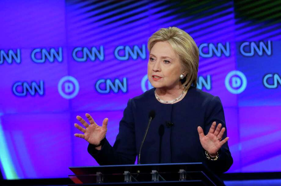 Democratic presidential candidate, Hillary Clinton makes a point during a Democratic presidential primary debate at the University of Michigan-Flint, Sunday, March 6, 2016, in Flint, Mich. (AP Photo/Carlos Osorio) Photo: Carlos Osorio, STF / AP
