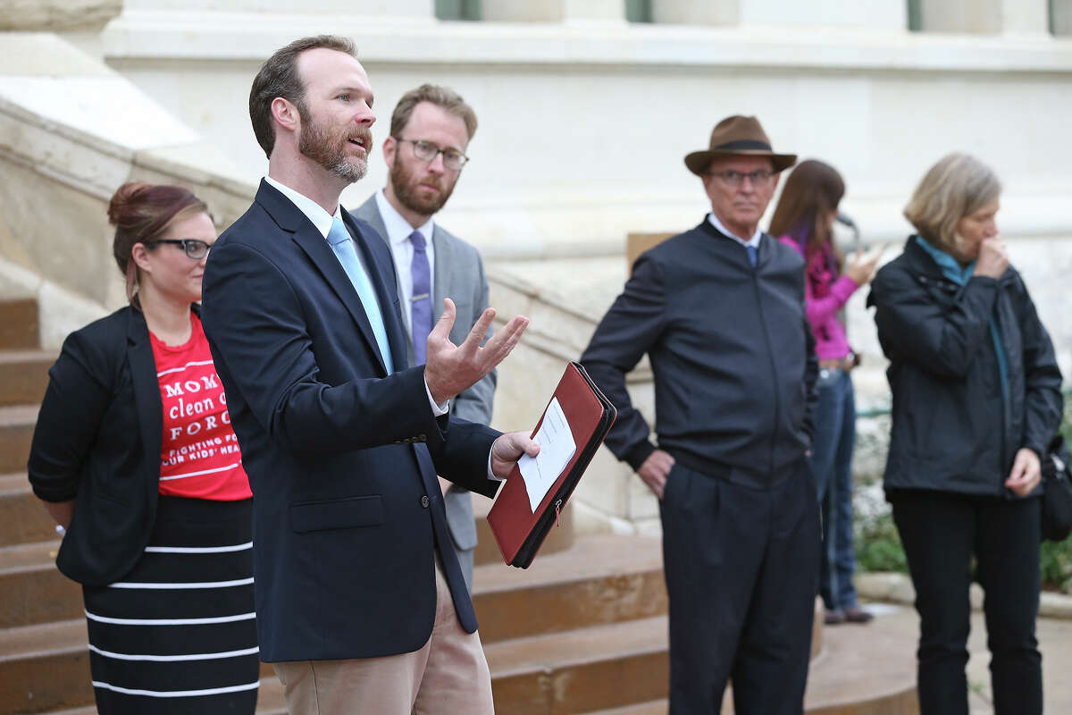 Chad Furo, a researcher at the University of Texas at San Antonio, states his case Wednesday as members of Environment Texas, Moms Clean Air Force and others gather outside City Hall to unveil an interactive map of extreme weather events that they say are linked to climate change.