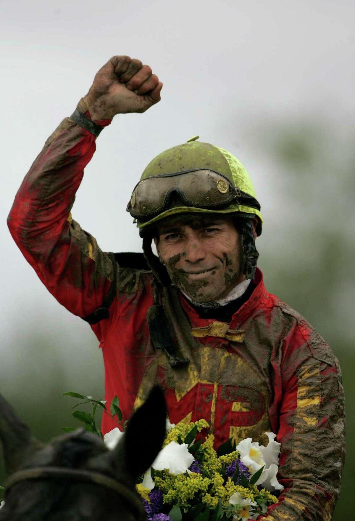 FILE - In this Oct. 27, 2007, file photo, jockey Garret Gomez celebrates aboard Midnight Lute after the Breeders Cup Sprint horse race in Oceanport, N.J. Jockeys Ramon Dominguez, Victor Espinoza, Garrett Gomez, and Craig Perret are among the 10 finalists on the National Museum of Racing Hall of Fame's ballot. (AP Photo/Mike Groll, File) ORG XMIT: NY173