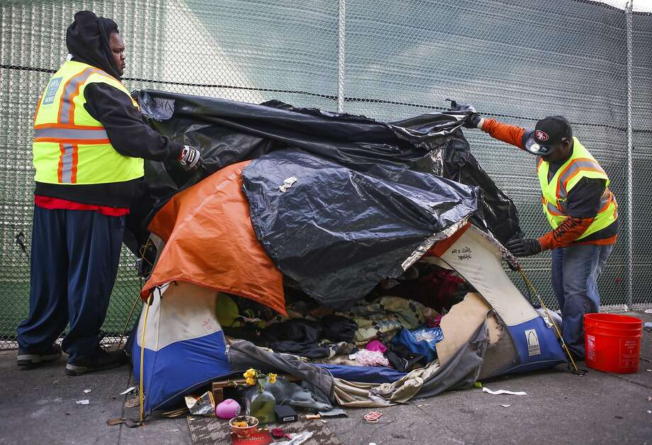 Department of Public Works clear an abandoned tent on Division Street. Photo: Gabrielle Lurie / Special To The Chronicle