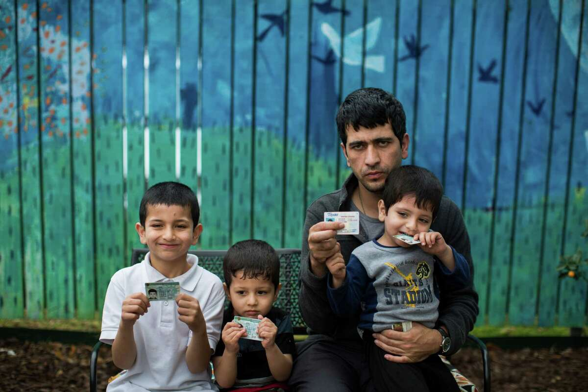 As is the case for many Afghans, just one name identified former U.S. military translator Rezashah and his sons: from left, Murid, 7; Murab, 4; and Mujib, 3. The family has petitioned to legally adopt a surname in the United States. Dozens of new arrivals in Houston face the same problem.