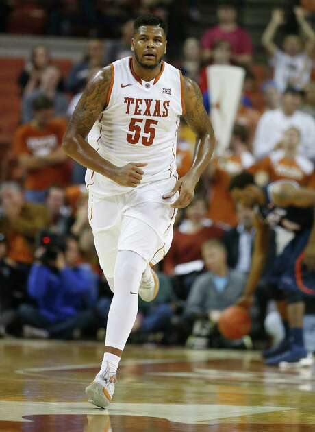 Texas' Cameron Ridley (55) runs up court after a score against UTSA in Austin on Tuesday, Dec. 8, 2015. The Longhorns defeated the Roadrunners, 116-50. (Kin Man Hui/San Antonio Express-News) Photo: Kin Man Hui, Staff / ©2015 San Antonio Express-News