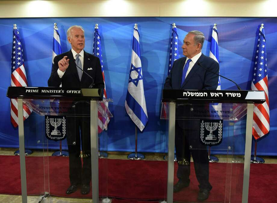 Vice President Joe Biden, with Israeli Prime Minister Benjamin Netanyahu, defended the amount of aid given to Israel by the Obama administration. Photo: DEBBIE HILL, POOL / POOL