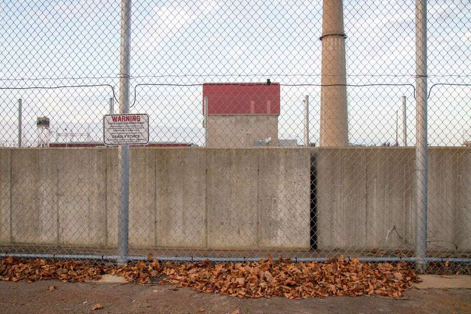 A fence along the James A. FitzPatrick Nuclear Power Plant, in Scriba, N.Y., Nov. 5, 2015. Since Entergy announced the shutdown of the plant, many residents of Oswego County have become anxious about the loss of jobs and the potential drain on the local economy. (Emma Tannenbaum/The New York Times) Photo: EMMA TANNENBAUM / NYTNS