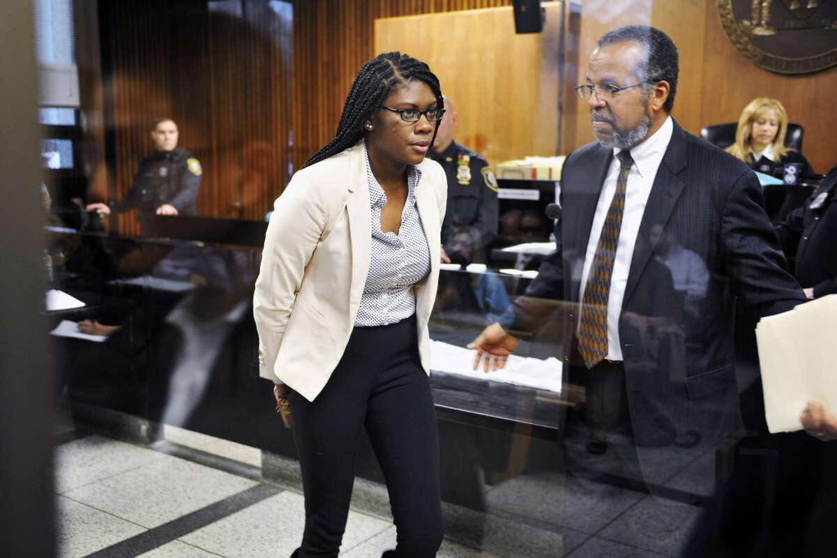 Asha Burwell leaves the front of the judge's bench at Albany City Criminal Court on Monday, Feb. 29, 2016, following her arraignment in Albany, N.Y. Burwell claimed a group of white men and women harassed her and others with racial slurs aboard a city bus and is being charged with assault. (Paul Buckowski/The Albany Times Union via AP, Pool) MANDATORY CREDIT ORG XMIT: NYALT204