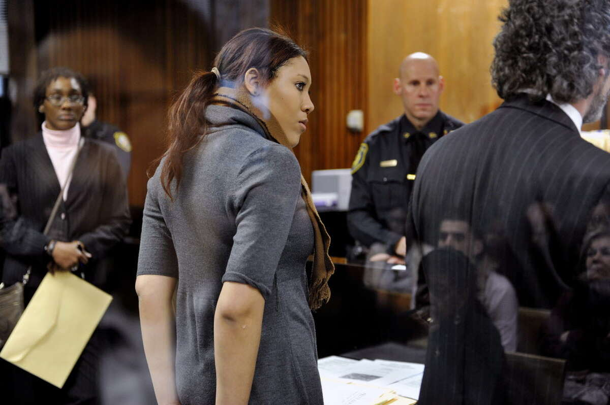 Ariel Agudio stands in front of the judge's bench at Albany City Criminal Court on Monday, Feb. 29, 2016, for her arraignment in Albany, N.Y. Agudio claimed a group of white men and women harassed her and others with racial slurs aboard a city bus and is being charged with assault. (Paul Buckowski/The Albany Times Union via AP, Pool) MANDATORY CREDIT ORG XMIT: NYALT203