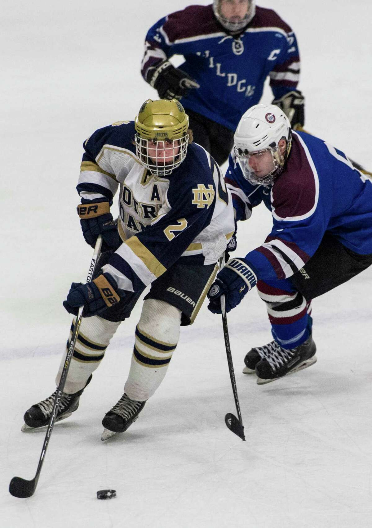 Notre Dame-Fairfield's Tyler Henchcliffe moves the puck into his teams offensive zone during a first round game of the CIAC division 1 boys ice hockey tournament against SGWL played at Milford Ice Pavillion, Milford, CT on Wednesday, March 9, 2016.