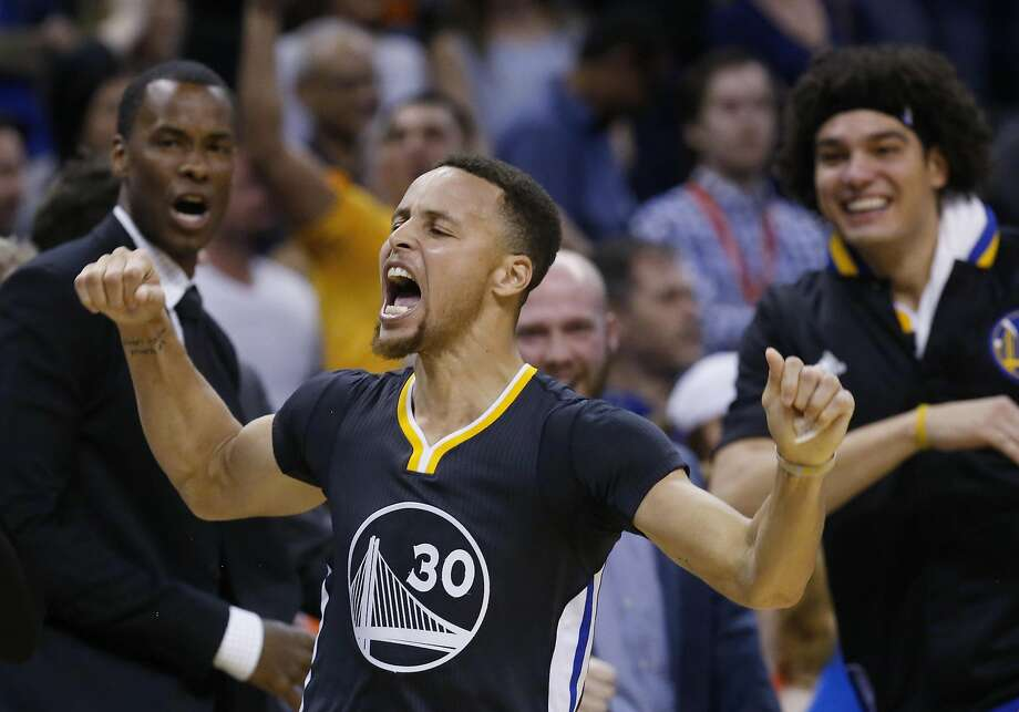Golden State Warriors guard Stephen Curry (30) celebrates after hitting the game-winning shot in overtime of an NBA basketball game against the Oklahoma City Thunder in Oklahoma City, Saturday, Feb. 27, 2016. Golden State won 121-118. (AP Photo/Sue Ogrocki) Photo: Sue Ogrocki, AP