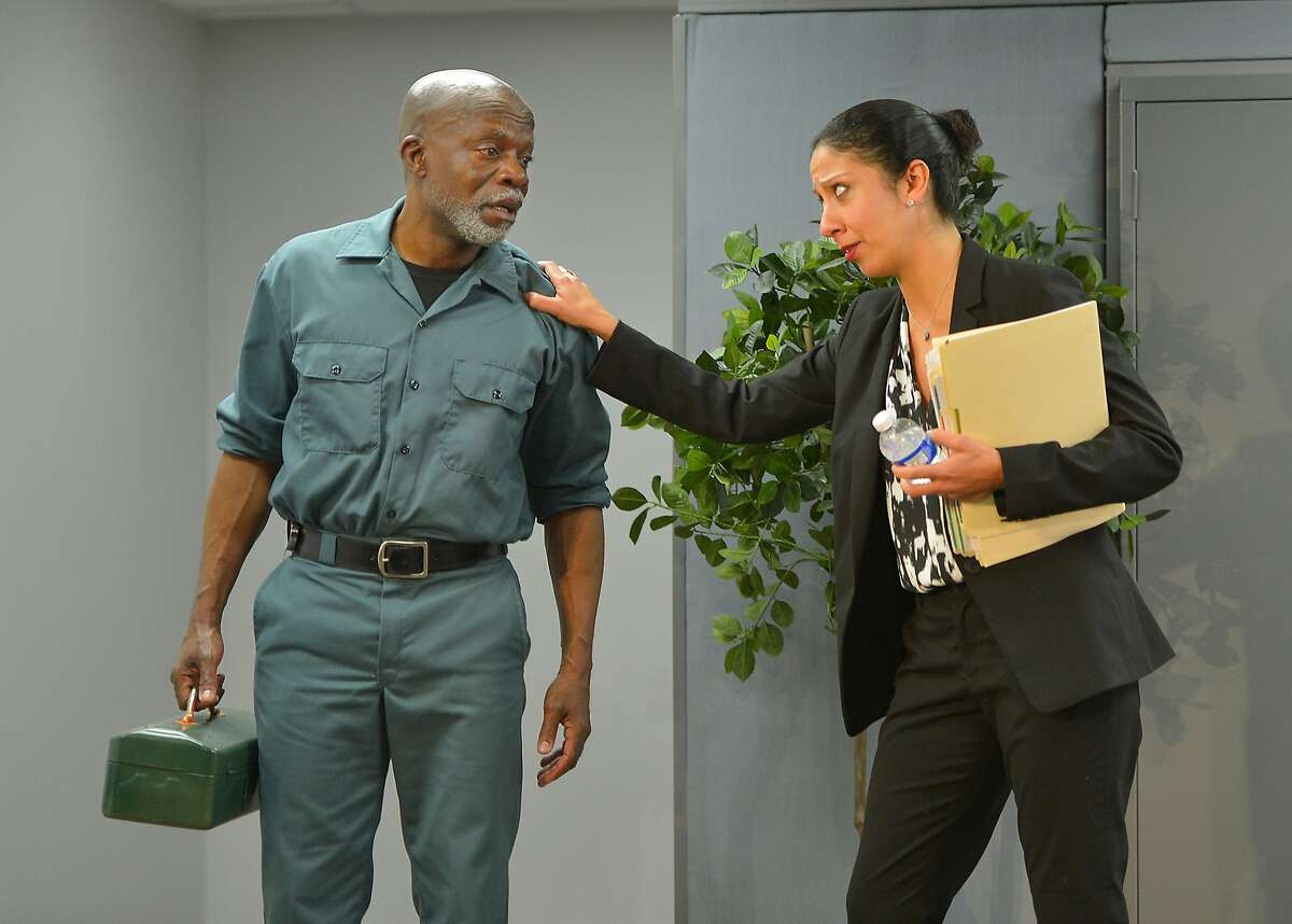Walter (L. Peter Callender, left) and Charlene (Sarah Nina Hayon) chat in the break room in