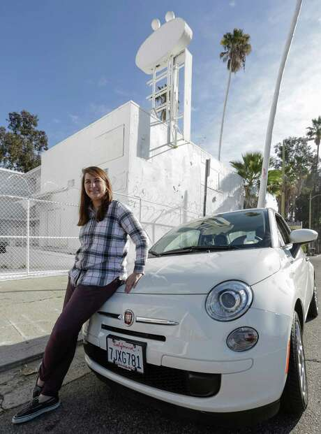 Lucy Mueller, 26, says she lived in Los Angeles for eight years without a car. Finally, last July, she bought a slightly used 2015 Fiat 500.  Photo: Damian Dovarganes, STF / AP