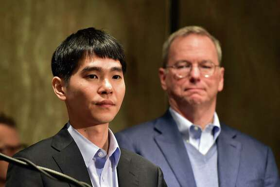 Lee Se-Dol (L), a legendary South Korean player of Go - a board game widely played for centuries in East Asia - stands with Eric Schmidt (R), the executive chairman of Google owner Alphabet, before a press conference after the first game of the Google DeepMind Challenge Match at a hotel in Seoul on March 9, 2016.   A Google-developed supercomputer stunned South Korean Go grandmaster Lee Se-Dol by taking the first game of a five-match showdown between man and machine in Seoul. / AFP / JUNG YEON-JEJUNG YEON-JE/AFP/Getty Images