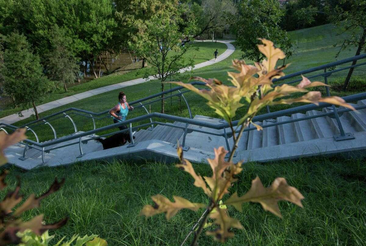 Krista Goodwin runs with her dog Jefferey in Buffalo Bayou Park Thursday, Sept. 17, 2015, in Houston. ( Jon Shapley / Houston Chronicle )