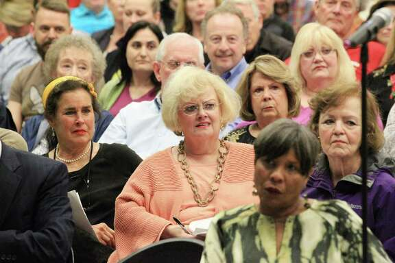 Wanda Cole, center, listens Wednesday as Houston Housing Authority officials speak about a proposed mixed-income complex.