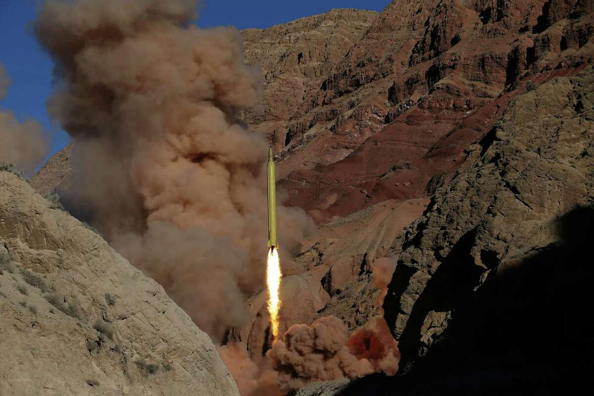 In this photo obtained from the Iranian Fars News Agency, a Qadr H long-range ballistic surface-to-surface missile is fired by Iran's powerful Revolutionary Guard, during a maneuver, in an undisclosed location in Iran, Wednesday, March 9, 2016. Iran?'s powerful Revolutionary Guard test-fired two ballistic missiles Wednesday with the phrase