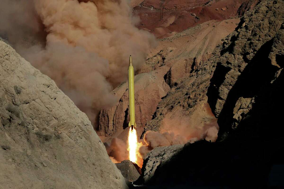 In this photo obtained from the Iranian Fars News Agency, a Qadr H long-range ballistic surface-to-surface missile is fired by Iran's Revolutionary Guard, during a maneuver, in an undisclosed location in Iran, Wednesday, March 9, 2016. Iran?'s powerful Revolutionary Guard test-fired two ballistic missiles Wednesday with the phrase
