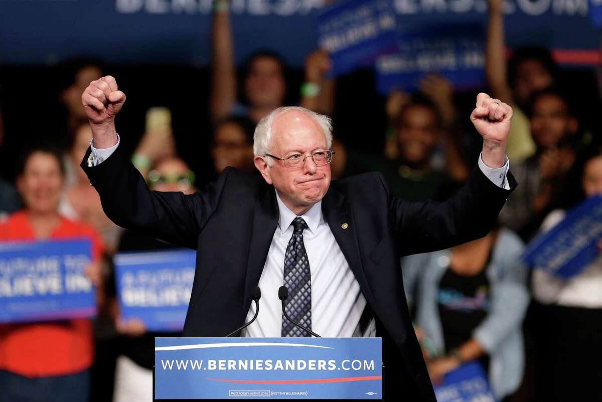 Democratic presidential candidate, Sen. Bernie Sanders, I-Vt. acknowledges his supporters on arrival at a campaign rally, Tuesday, March 8, 2016, in Miami. (AP Photo/Alan Diaz) ORG XMIT: FLAD101
