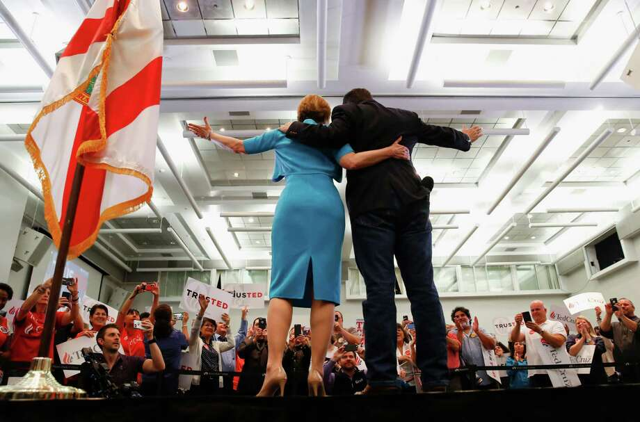 Former Republican presidential hopeful Carly Fiorina, who endorsed Ted Cruz, join him during a campaign rally in Miami. Photo: Paul Sancya / Associated Press / AP