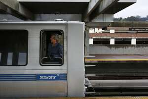 A train conductor looks out his window before pulling out of the El Cerrito del Norte BART station March 9, 2016 in El Cerrito, Calif.