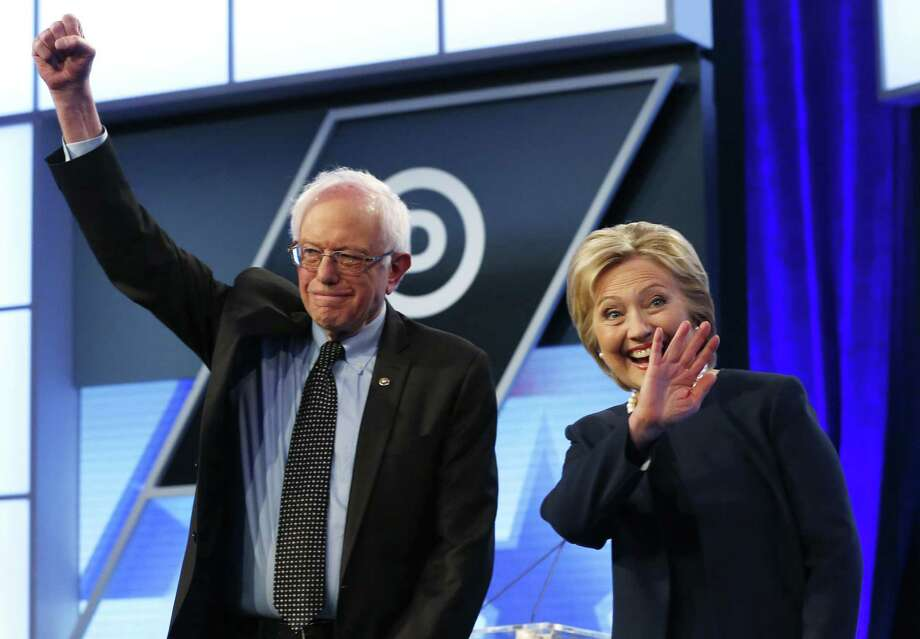 Democratic presidential candidates, Hillary Clinton and Sen. Bernie Sanders, I-Vt.,  stand together before the start of the Univision, Washington Post Democratic presidential debate at Miami-Dade College, Wednesday, March 9, 2016, in Miami. (AP Photo/Wilfredo Lee) Photo: Wilfredo Lee, STF / AP