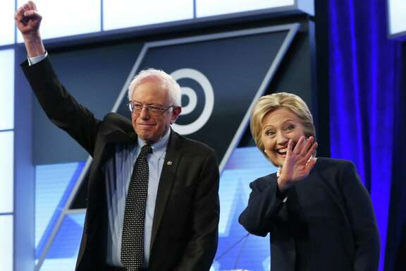Democratic presidential candidates, Hillary Clinton and Sen. Bernie Sanders, I-Vt.,  stand together before the start of the Univision, Washington Post Democratic presidential debate at Miami-Dade College, Wednesday, March 9, 2016, in Miami. (AP Photo/Wilfredo Lee)