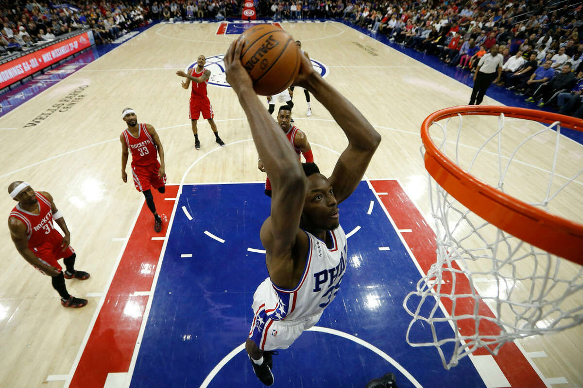 Philadelphia 76ers' Jerami Grant goes up for a dunk during the first half of an NBA basketball game against the Houston Rockets, Wednesday, March 9, 2016, in Philadelphia.