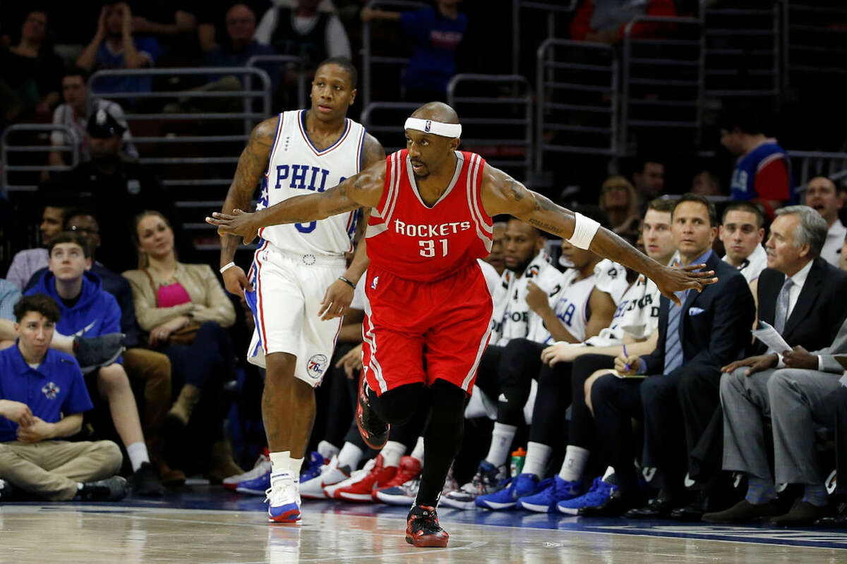 Houston Rockets' Jason Terry, right, reacts after making a three-pointer past Philadelphia 76ers' Isaiah Canaan during the second half of an NBA basketball game, Wednesday, March 9, 2016, in Philadelphia. Houston won 118-104.