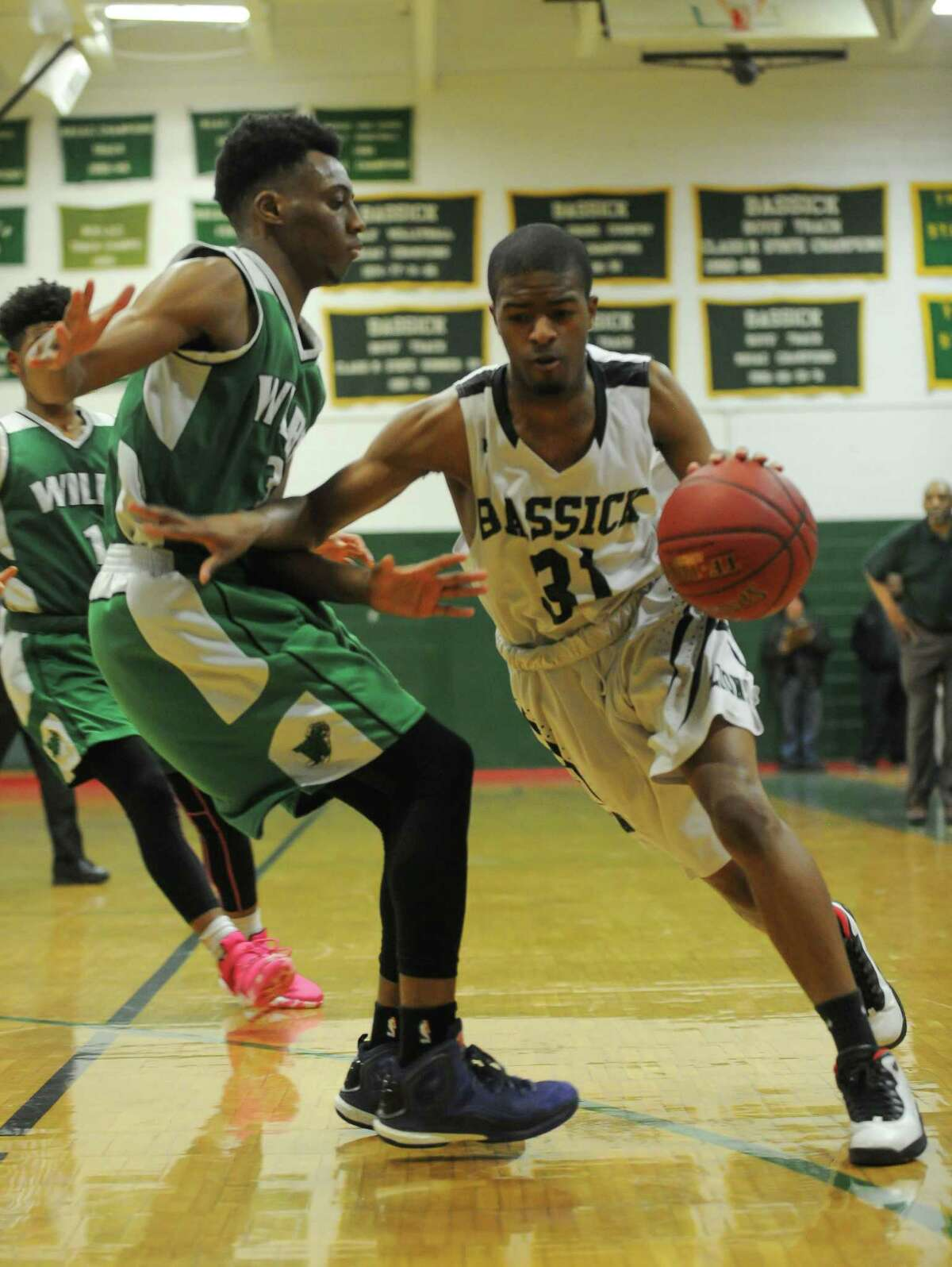Basketball action during the second round of the Connecticut Class L Basketball Championships between the Bassick Lions and the Wilby Wildcats at Bassick High School on March 9, 2016 in Bridgeport, Connecticut.