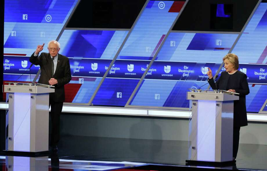 Democratic presidential candidates, Sen. Bernie Sanders, I-Vt,  and Hillary Clinton interrupt each other during the Univision, Washington Post Democratic presidential debate at Miami-Dade College,  Wednesday, March 9, 2016, in Miami. Photo: Wilfredo Lee, AP / AP