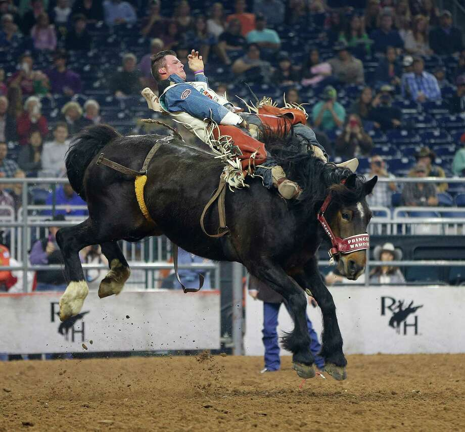 Richie Champion competes in the Super Series III championship bareback riding event during the Houston Livestock Show and Rodeo at NRG Stadium, Wednesday, March 9, 2016. Photo: Karen Warren Karen Warren, Houston Chronicle / © 2015  Houston Chronicle