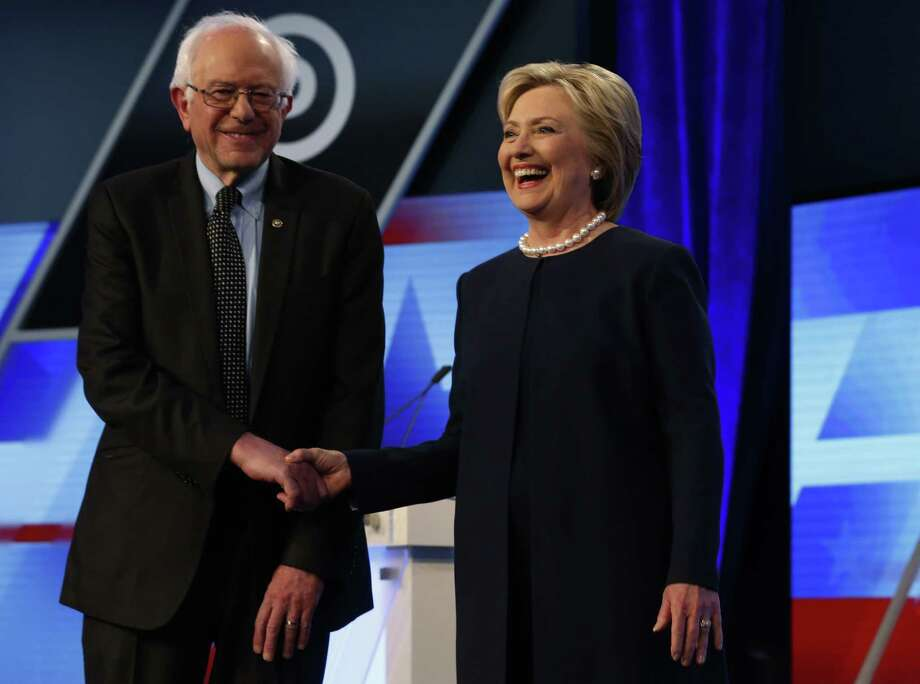 Democratic presidential candidates, Hillary Clinton  and Sen. Bernie Sanders, I-Vt,  shakes hands before the start of the Univision, Washington Post Democratic presidential debate at Miami-Dade College,  Wednesday, March 9, 2016, in Miami, Fla. (AP Photo/Wilfredo Lee) Photo: Wilfredo Lee, STF / AP / AP