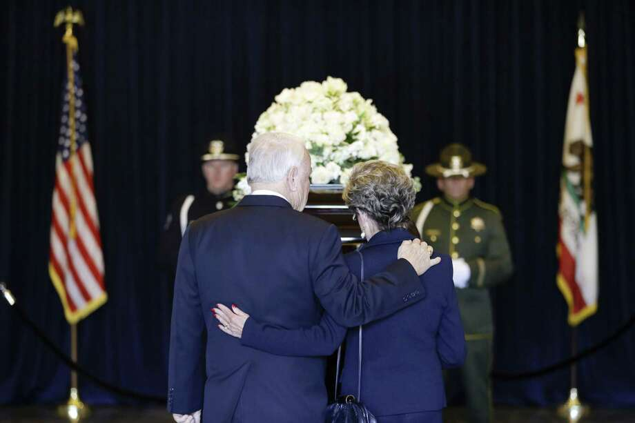 A couple pause as they pay their respects beside the casket of Nancy Reagan at the Ronald Reagan Presidential Library in Simi Valley, Calif. Photo: Jae C. Hong / Getty Images / 2016 Getty Images