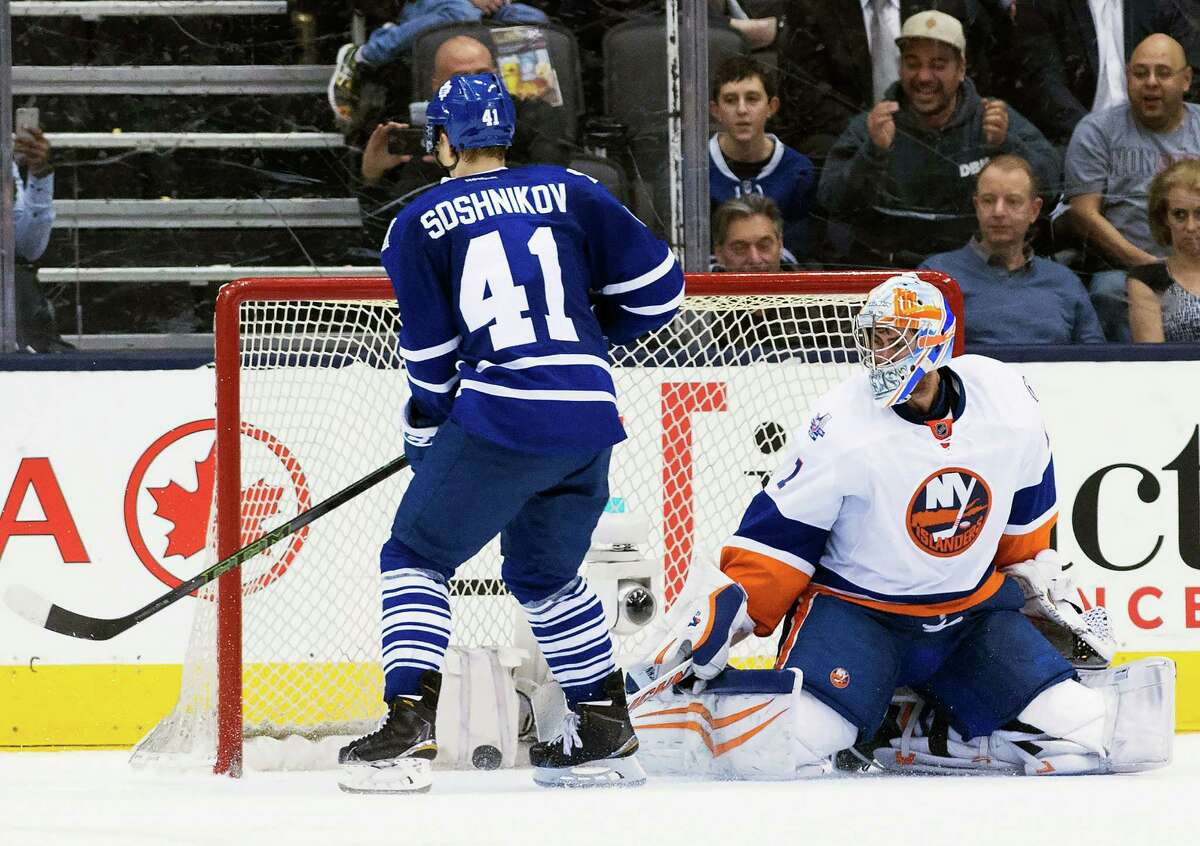 Toronto Maple Leafs right wing Nikita Soshnikov (41) scores the game-winning shoot out goal past New York Islanders goalie Thomas Greiss (1) during an NHL hockey game in Toronto, Wednesday, March 9, 2016. (Nathan Denette/The Canadian Press via AP) MANDATORY CREDIT ORG XMIT: NSD112
