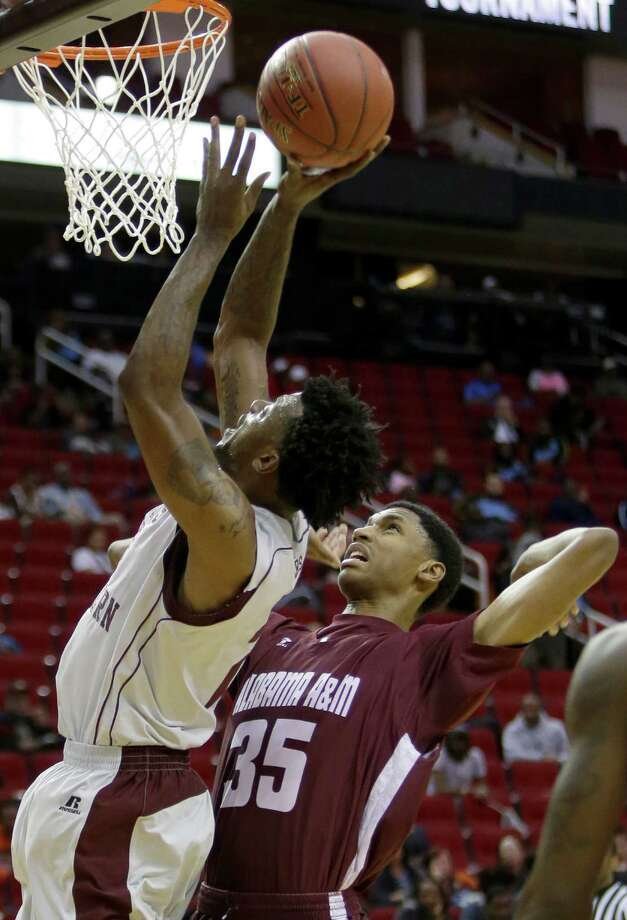 Texas Southern University Chris Thomas shoots over Alabama A&M Nicholas West during first half game during the SWAC tournament at Toyota Center Wednesday, March 9, 2016, in Houston. ( Melissa Phillip / Houston Chronicle ) Photo: Melissa Phillip Melissa Phillip, Staff / © 2016 Houston Chronicle