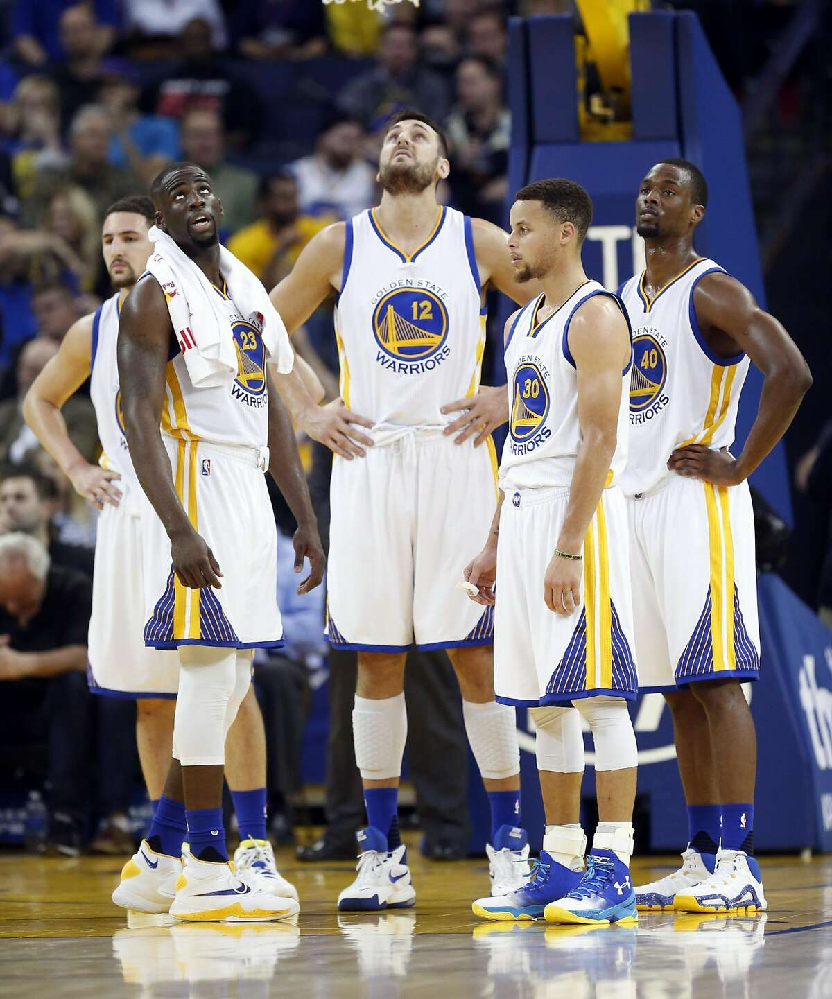 Golden State Warriors' Klay Thompson, Draymond Green, Andrew Bogut, Stephen Curry and Harrison Barnes wait out a video replay during Warriors' 115-94 win over Utah Jazz during NBA game at Oracle Arena in Oakland, Calif., on Wednesday, March 9, 2016.