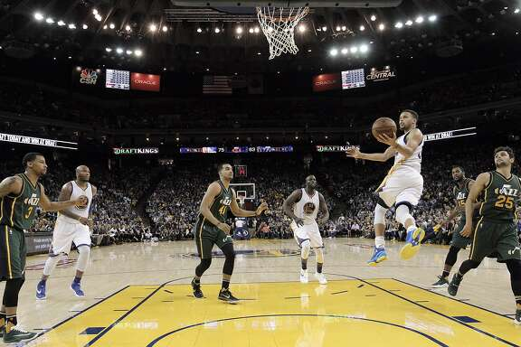 Stephen Curry (30) flies in for a shot in the second half as the Golden State Warriors played the Utah Jazz at Oracle Arena in Oakland, Calif., on Wednesday, March 9, 2016.
