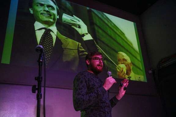 Presenter Bairan Jacobsohn, of Zynga, is tasked with improvising a presentation on a subject without knowing what slides will be coming next, as he performs on stage at a show called Speechless, at Public Works in San Francisco, California, on Wednesday, March 9, 2016.