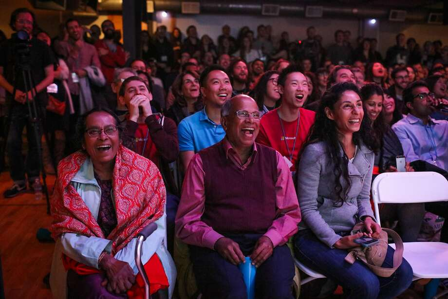 Haimanti Dorai, Gempu Dorai and Esha Datta cheer as they watch Amal Dorai (not pictured), of Microsoft perform improv, at Public Works in San Francisco, California, on Wednesday, March 9, 2016. Photo: Gabrielle Lurie, Special To The Chronicle