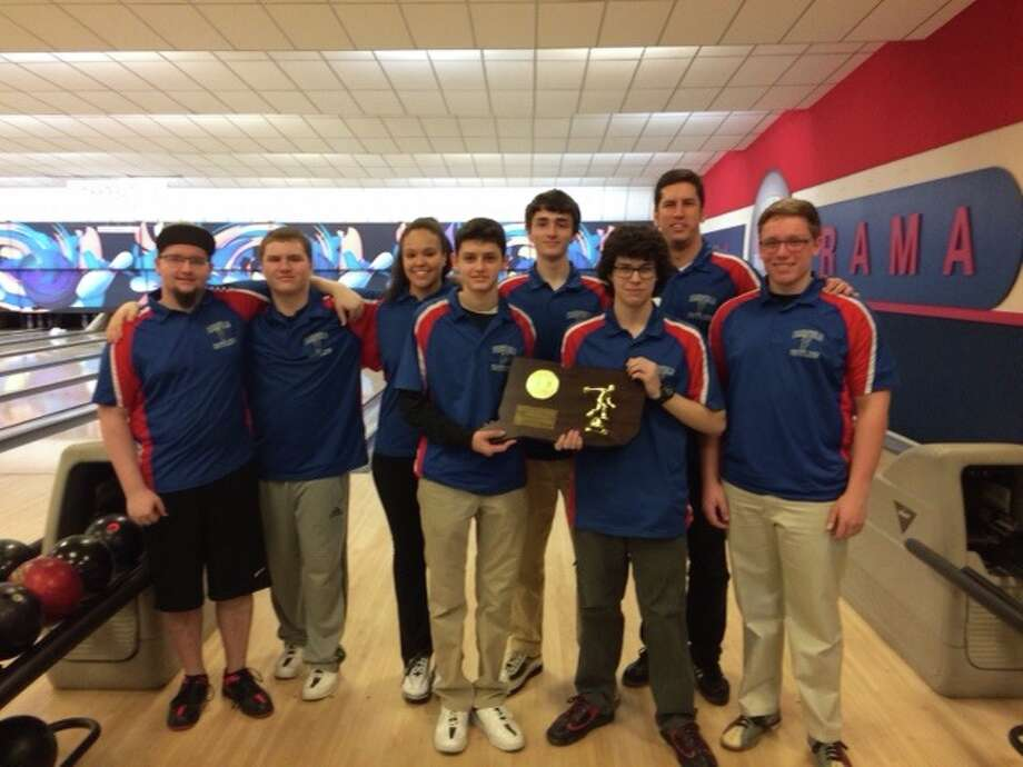 Members of the Fairfield co-op bowling team pose with the championship trophy after winning the 2016 CIAC title over Bethel at the Bowl-O-Rama in Newington. Photo: Contributed