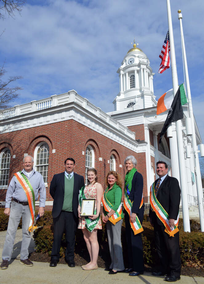 Grand Marshal Elizabeth Feser, superintendent of schools, second from right, will lead Milford's St. Patrick's Day Parade on Saturday, March 12, beginning at 1 p.m. In advance of the parade, Feser, Miss Emerald Isle Kelly Scianna, center, Irish Man of the Year Michael McCabe, far right, and Irish Woman of the Year Woman Jane McSally, third from right, gathered at City Hall on Monday with Parade Chairman Marty Hardiman, far left, and Mayor Ben Blake, second from left, to raise the flag of Ireland. Photo: Contributed Photo / Connecticut Post Contributed