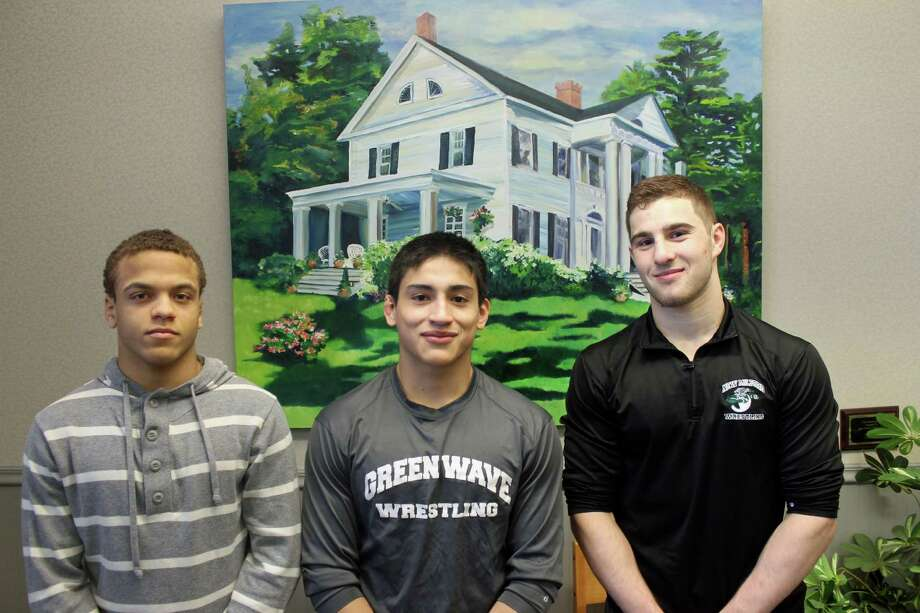 From left, sophomore Mel Ortiz, senior Bryan Rojas and senior Brett Leonard are heading to Nationals after medaling for New Milford High School last week at the New England Wrestling Championships. Leonard captured the New England title at 160 pounds, while Ortiz (120) and Rojas (145) each placed fifth. All three wrestlers won their weight classes at the Class L state championships to help lead the Green Wave to the team title. Photo: John Nestor / For Hearst Connecticut Media / The Greater New Milford Spectrum