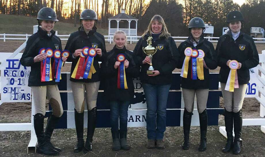 Champions!  The Cavalier Farm IEA Team in New Milford recently garnered the title of champion at Regional Finals Feb. 27 at Oak Meadow Farm in East Windsor. The team is made up of, from left to right, Alycia Petrauskas, Chelsea LeMoine, Devon LeMoine, coach Cheryl LeMoine, Jordan Guilmart and Annie Fournier. Chelsea and Alycia also won their individual classes. The team has qualified for Zone 1 Finals at Mount Holyoke College March 25-26. They ride with Cheryl Lemoine at Cavalier Farm. Photo: Courtesy Of Cavalier Farm / The News-Times Contributed