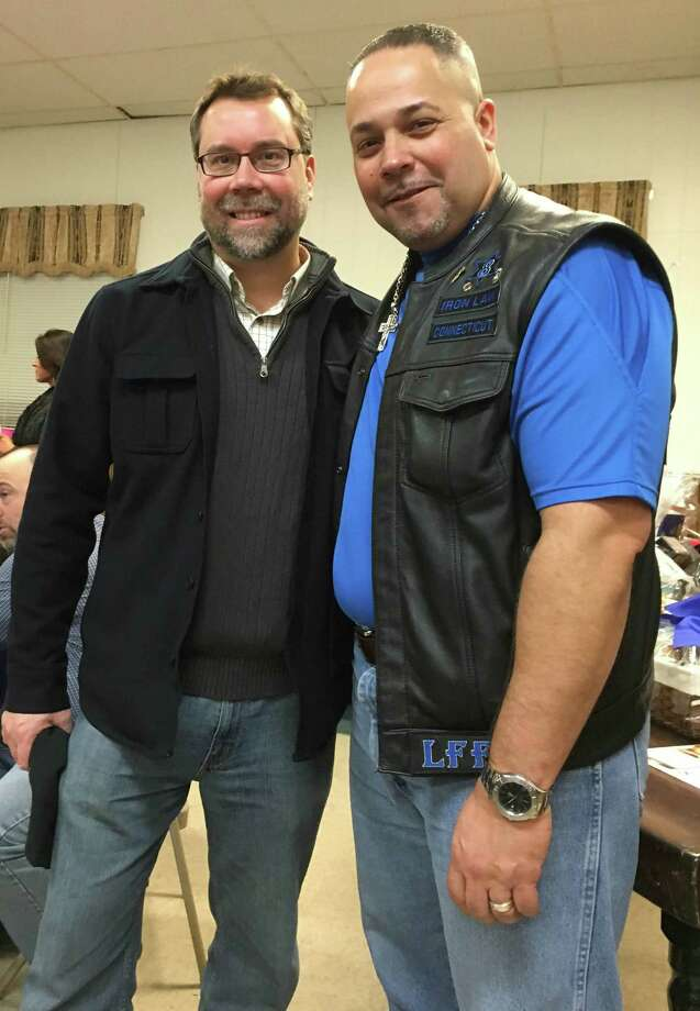 Anthony Rivera, president of the motorcycle club, right, welcomes New Milford Mayor David Gronbach to a Feb. 20 fundraiser to benefit the Turco Children's Fund. The event was coordinated by the Iron Law Law Enforcement Motorcycle Club in New Milford. Photo: Courtesy Of Anthony Rivera / The News-Times Contributed