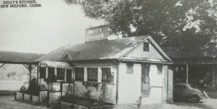 """Flashback: Dolly's Kitchen Railroad Street in New Milford has been home to numerous eating establishments over the years. The building that housed Dolly's Kitchen, above, was erected in 1890 and drew customers from the community and beyond. Its prime location next to the railroad tracks made it a popular destination. The building at 73 Railroad Street still stands today - and features the gable over the door - and is home to Dolly's Wine Boutique. """"Flashback"""" photographs are sought. If you have a """"Flashback"""" photo to share, contact Deborah Rose at drose@newmilford or call 860-355-7324. Photo: Courtesy Of """"Images Of America: New Milford Revisited"""" / The News-Times Contributed"""